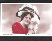 Vintage POSTCARD Real Photo of British Edwardian Stage Star Actress Edna May large hat and dog in a theatrical play scene