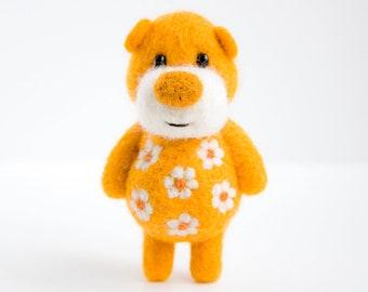 Deep orange pocket bear with daisies