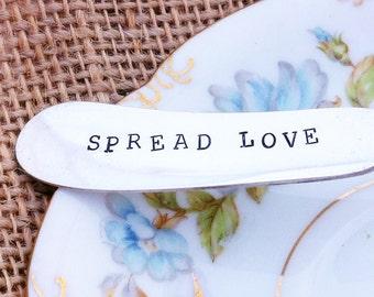Eight Hand Stamped Vintage Silver Plate Spread Love Butter Knives