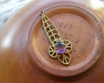 Vintage gold filigree and amethyst glass pendant