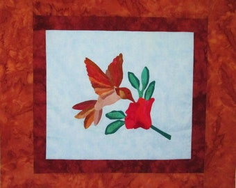 Quilted Wallhanging - Appliqued Hummingbird  and Red Flower Against Pale Blue Background with Rust Borders