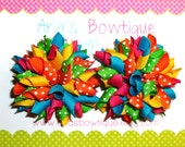 A Pair Of Bright And Happy Mini Korker Bows