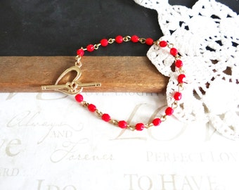 LOVEABLE in scarlet red beaded toggle bracelet with heart toggle closure (gold)