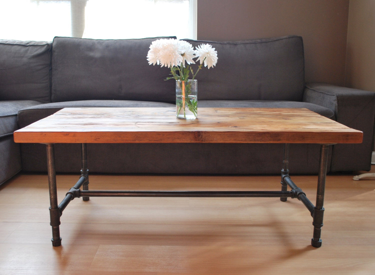 Wood Coffee Table With Steel Pipe Legs Made Of By UrbanWoodGoods. Full resolution‎  photograph, nominally Width 1500 Height 1101 pixels, photograph with #9E4E2D.