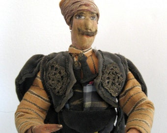 beautiful antique figure of man in a turban and fancy native dress, with swords