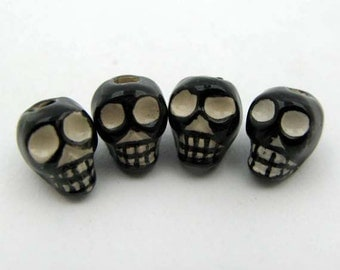 4 Black Skull Beads - vertical - CB648