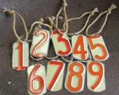 Recycled license plate number tags.