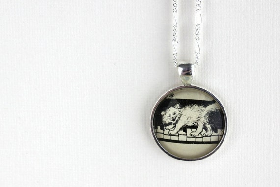 Cat necklace kitten on piano key keyboard black and white illustration pendant from vintage sheet music back to school gift