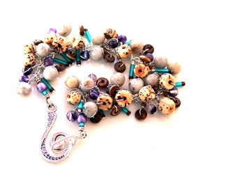 beadwork bracelet / buri nut spirals. feldspar bracelet. wire wrapped gemstones, purple teal sticks brown bracelet