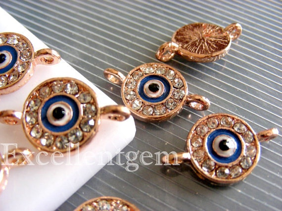 5pcs Rose gold tone with clear crystal rhinestone evil eye connector beads in deep blue color.