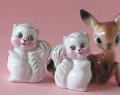White squirrels with gold and with pink ears salt and pepper shakers