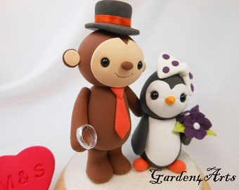 Custom Wedding Cake Topper--Monkey and Penguin Love with Wedding Ring and circle clear base