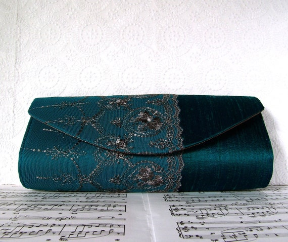 Teal silk clutch purse with lace overlay. Formal clutch bag