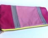 SALE Leather colour block clutch bag with neon zipper detail