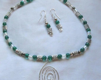 Green Celtic necklace with silver pendant.