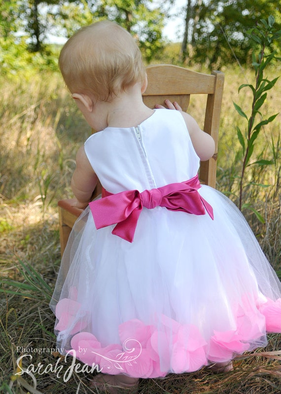 White or ivory flower girl dress with petals in the tulle skirt. Crinoline puffy ballerina style tutu dress.