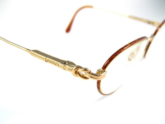 GUCCI vintage eyeglasses. round with tortoiseshell inlay. gold