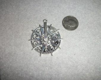Rhynstone and silver rowel pendant