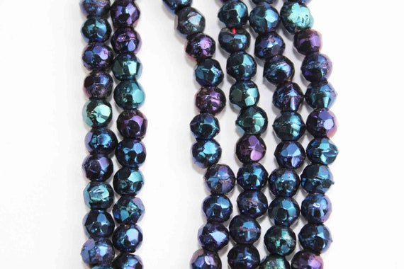 English cuts beads - 1920s - 144 beads - rough faceted glass beads - metallic blue to purple and ultramarine green - whole hank - 4mm