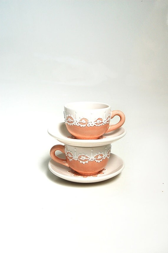Small teacups with peach shabby chic style