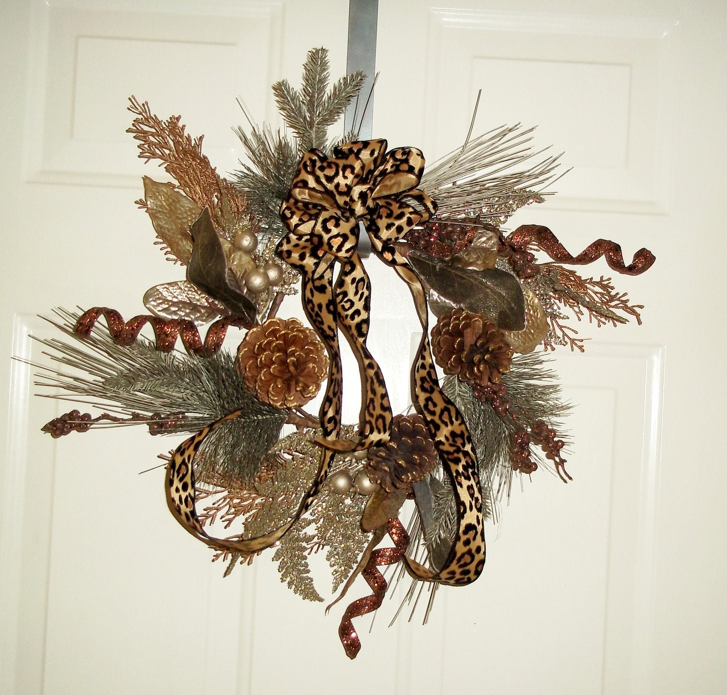 Brown and bronze winter wreath with leopard bow christmas
