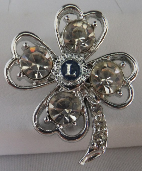 Vintage jewelry brooch in silver tone with clear rhinestone and Lions club L in center clover leaf brooch Presidents sale