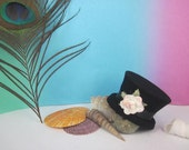 black mini top hat with flower and satin ribbon