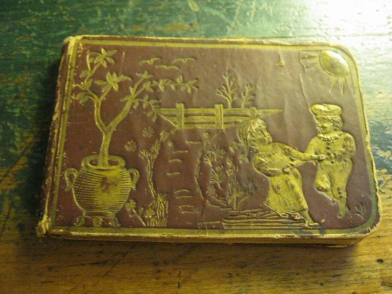 a small autograph book from 1888... embossed cover...3 inches by 4 1/4 inches...