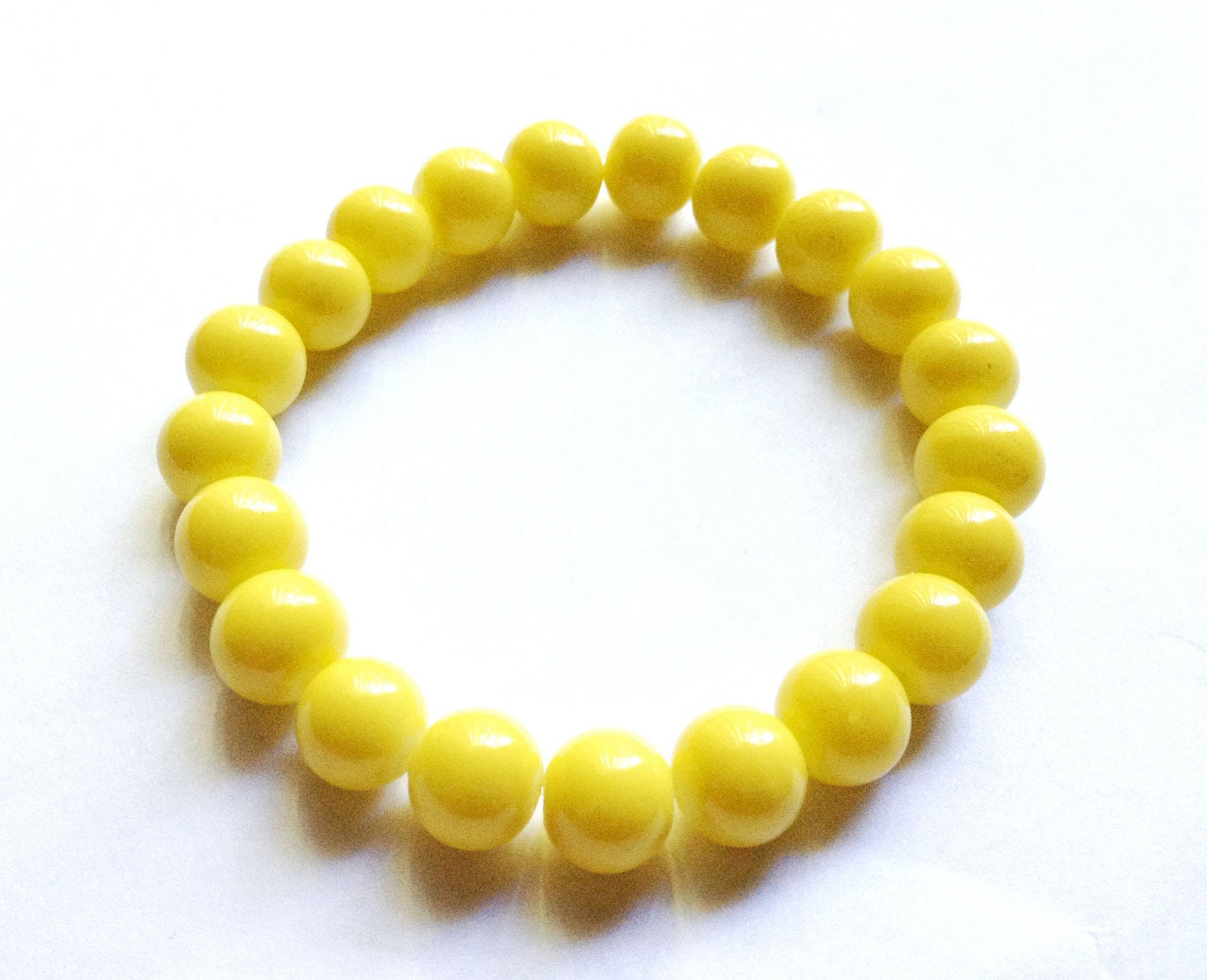 bright yellow bead bracelet arm for layering