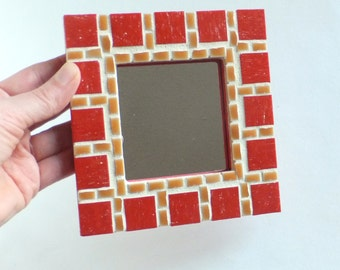 Red Decorative Mirror with Russet Detailing
