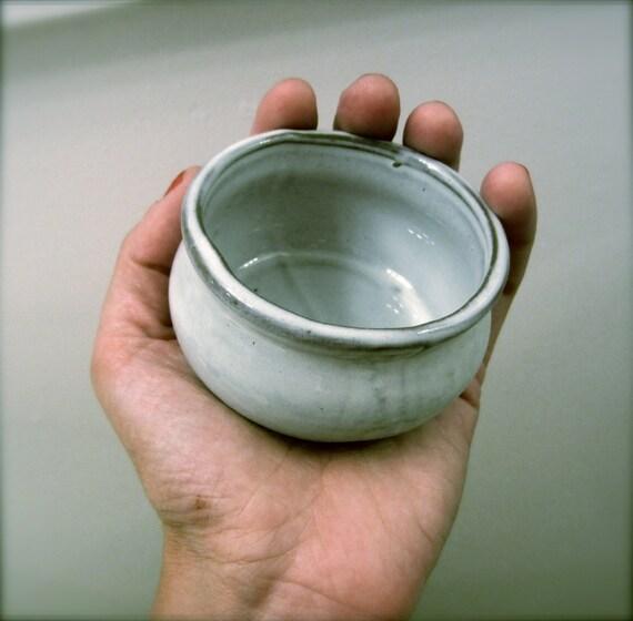 Small ceramic cup/bowl/pot. Light blue.