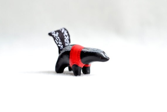 skunk in a sweater - miniature skunk figurine