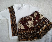 Matching Boys Hawaiian Print T-Shirt and Shorts in Brown, Tan, and White.  Has a small smudge on left shoulder.  SOLD AS IS