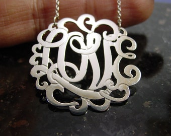 """Love  necklace,  sterling   silver  1.5""""diameter. with a 16"""" chain"""