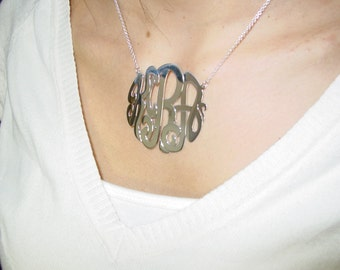 "sterling silver monogram necklace 2""size. with a  silver chain."