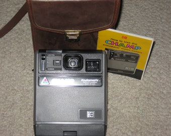 ON SALE Vintage Champ, a Kodamatic Instant Camera with camera case and instruction booklet
