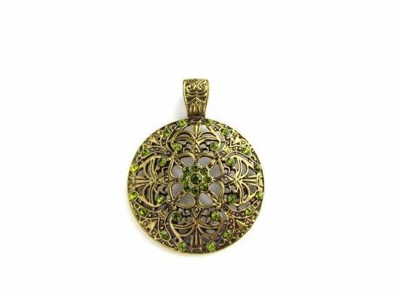 Beautiful Antiqued Brass Pendant w/ green Stones