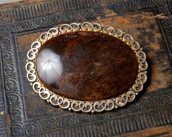 Vintage big metal brooch with stone cabochon.