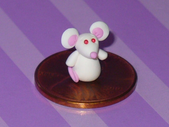 Marvel the Miniature White Mouse