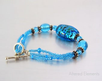Turquoise Glass Bracelet - Beaded Bracelet in Turquoise with Black Accents - Lampwork Glass and Crystal - Triple Strand Bracelet