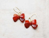 no. 96 - blood red carved carnelian bow and gold earrings