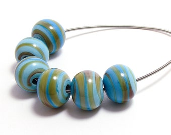 Lampwork beads shades of blue with yellowish spiral set of six