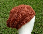 Slouch Hat beanie stocking cap or beret pumpkin rust orange hand knit with seed stitch details