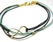 Infinity bracelet in light teal, gold, and black