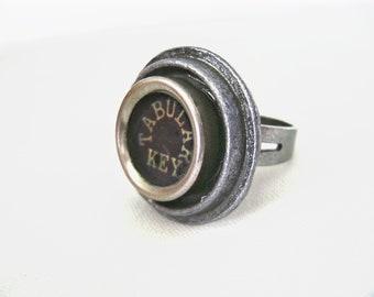 Typewriter key ring with tabular key in black, on adjustable silver gunmetal ring, tab function key