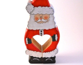 Santa made of wood with a heart cut into his middle