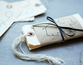 hand-stamped tags for baby gifts