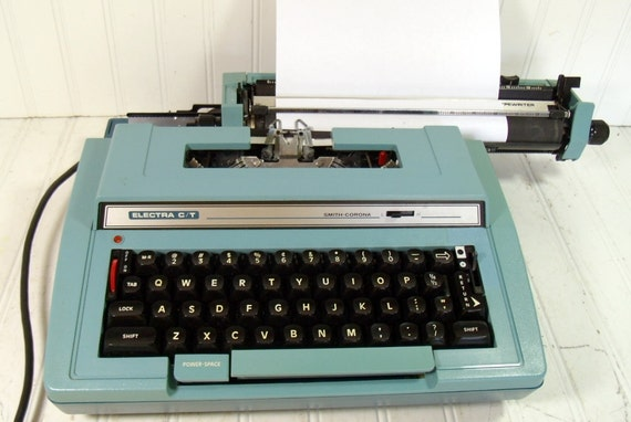 Smith-Corona Electra C/T Typewriter - Vintage Electric Correction Typing Keyboard - Turquoise Blue Body with Brown Carry Case