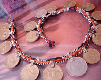 Orange string with gold colour coins