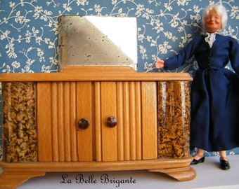Vintage wooden dollhouse vanity with mirror.